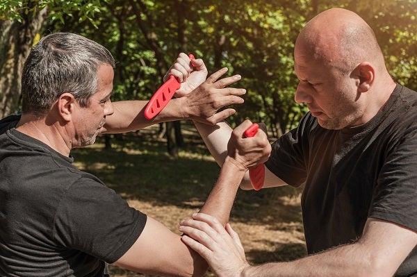 two men using training knives